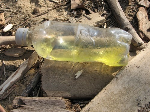 Bottle w/yellow liquid
