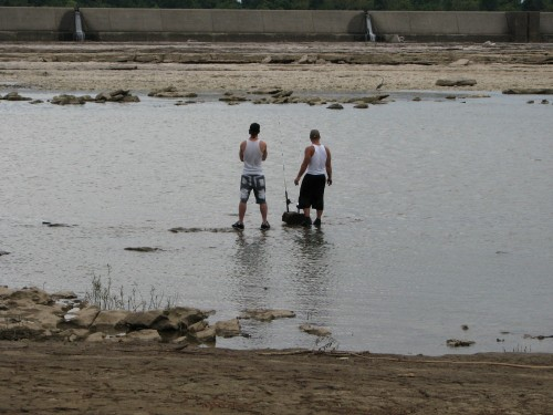 Two guys fishing in the middle of the river. 8/09
