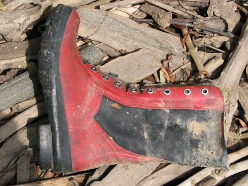 tall red and black boot
