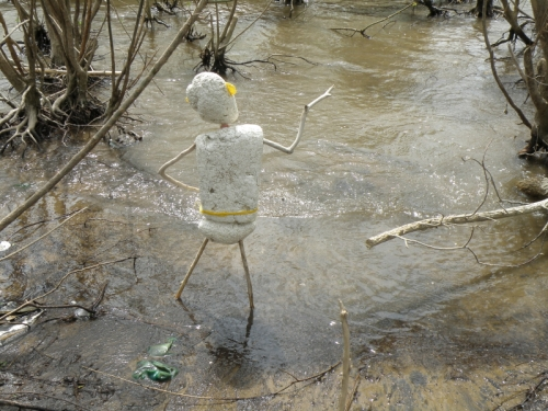 Polystyrene figure standing in water, May 2013
