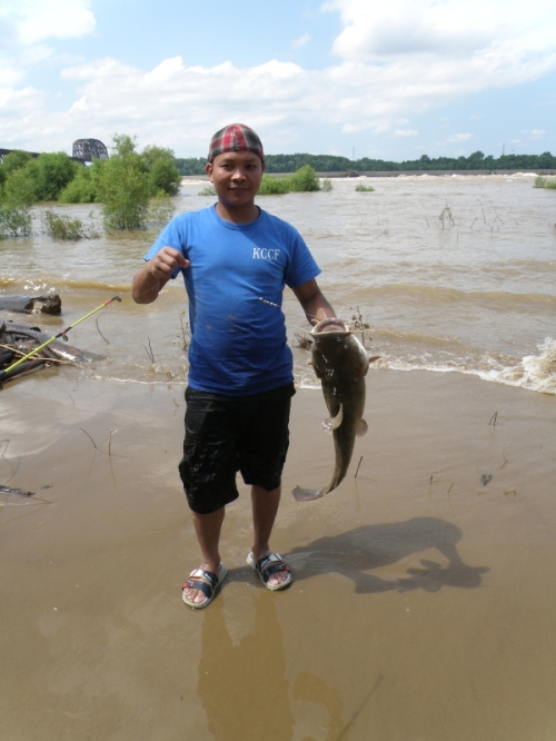 Man with Flathead Catfish, Falls of the Ohio, July 2013