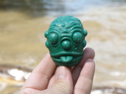 green toy character head sticking out its tongue, July 2013