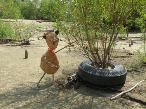 Orangeman and willow/tire tree, late Aug. 2013, Falls of the Ohio