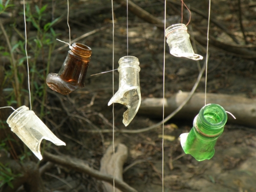 detail, various glass bottlenecks suspended by waste fishing line, 2013