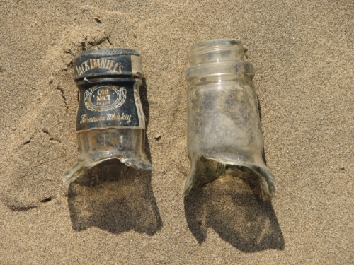 two glass bottlenecks on sand, 2013