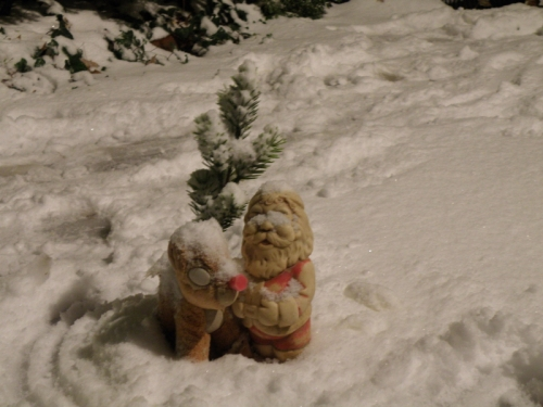 Heavy snow covers Rudolph and Santa, Dec. 2013