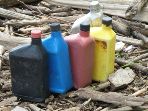 various colorful plastic oil containers, Falls of the Ohio, May 2014