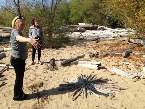 Visitors interacting with my art, Falls of the Ohio, Oct. 2014
