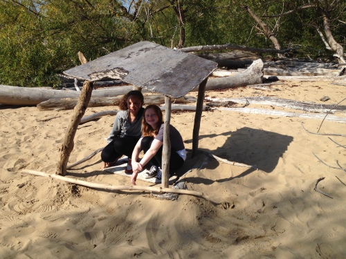 Girls posed under their improvised shelter, Falls of the Ohio, Oct. 2014