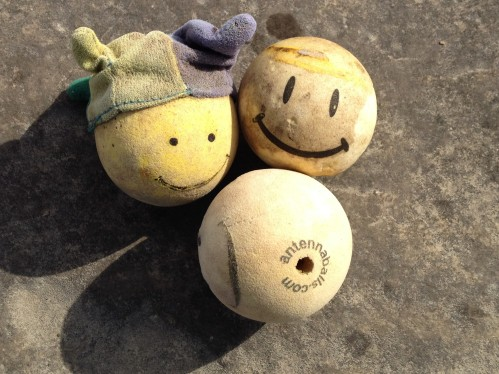 Three smiley face antenna balls, found at the Falls of the Ohio State Park