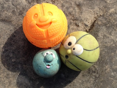 Three hard plastic face balls found at the Falls of the Ohio.