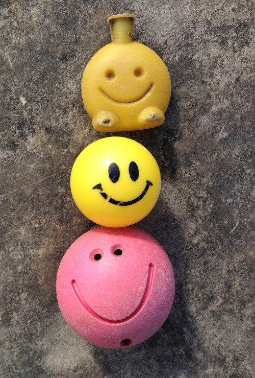 A trio of plastic smiley faces found at the Falls of the Ohio