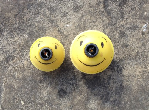 Two smiling face fishing floats from the Falls of the Ohio