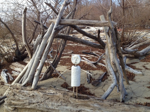 Styro-figure posed next to anonymous improvised driftwood shelter, Falls of the Ohio, Nov. 2014