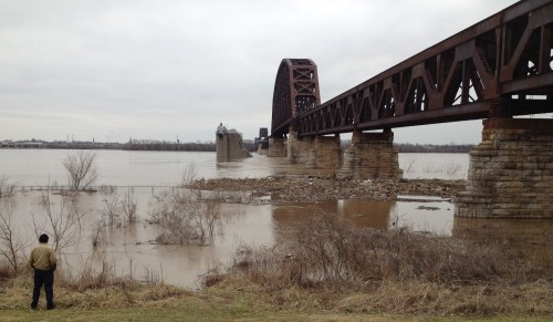 Man by the railroad bridge, flooded Falls of the Ohio, March 2015