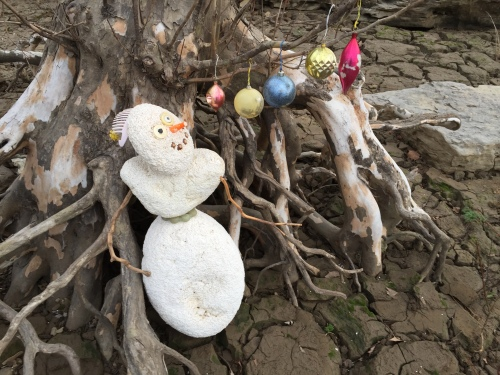 Styro-snowman with baubles arranged all in a row, Falls of the Ohio, Dec. 2015