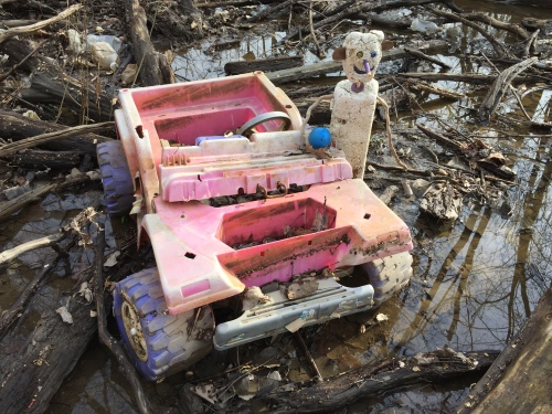 Styrofigure with found, plastic battery operated car, Falls of the Ohio 2017