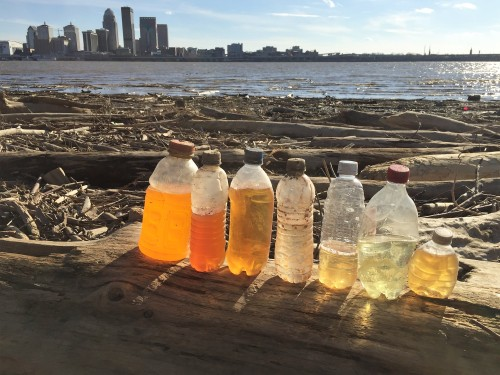 Found bottles and contents with the skyline of Louisville, Feb. 2017