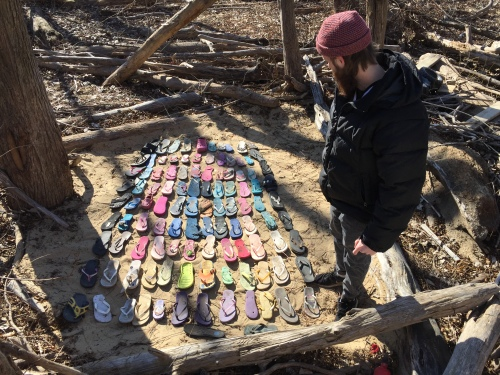 Jason Moore with his found flip-flop design at the Falls of the Ohio.  Dec. 2017